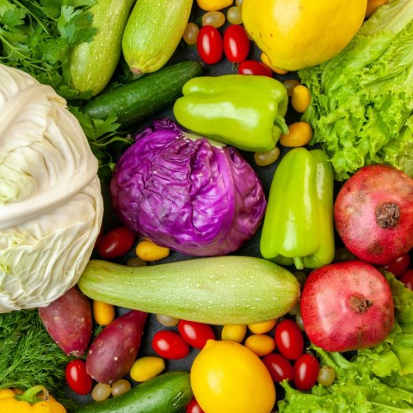 top-view-vegetables-and-fruits-zucchini-bell-peppers-apples-quince-cherry-tomatoes-cumcuat-parsley-cabbage-lemon-pomegranates